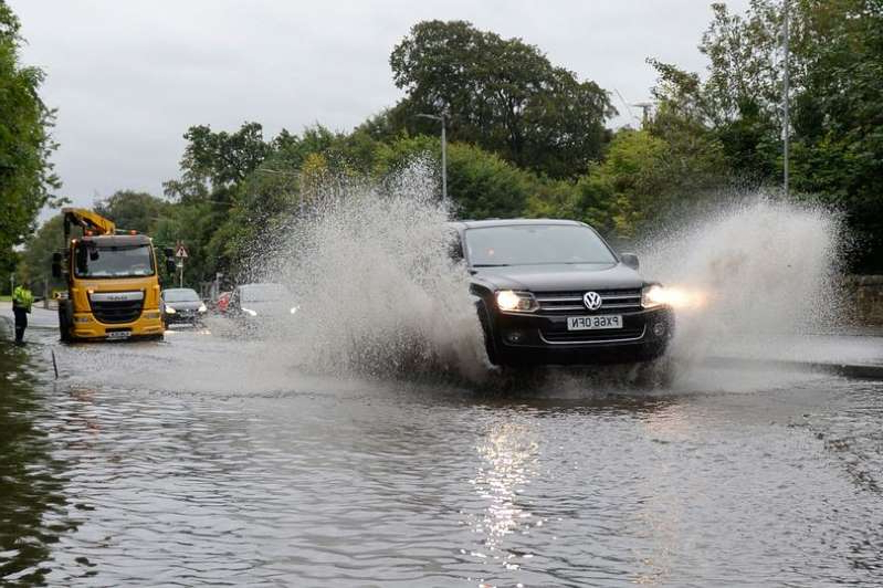 a car driving through water: Heavy rain is expected for large parts of Scotland on Monday