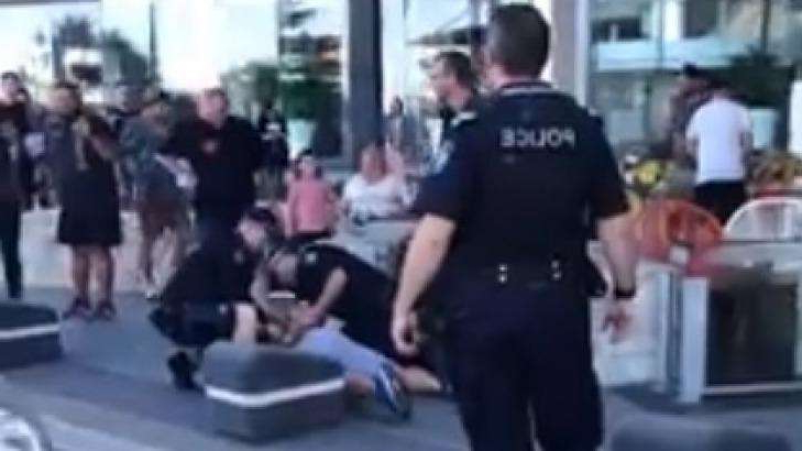 a group of people riding on the back of a person: Police make an arrest after