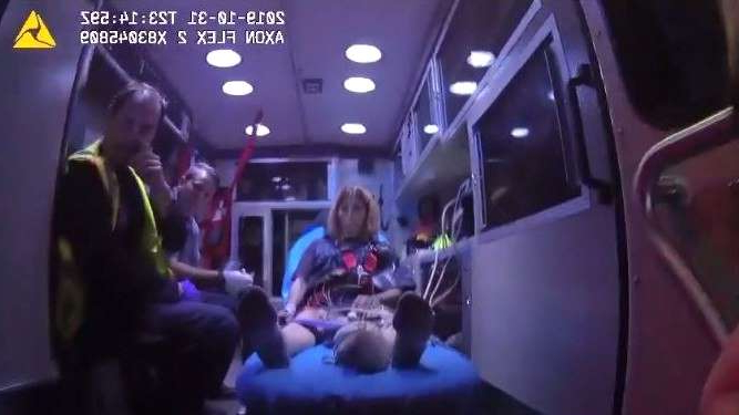 a person sitting on a bus: Tiffany Smith is treated in an ambulance before she was admitted to AdventHealth Fish Memorial in Orange City.
