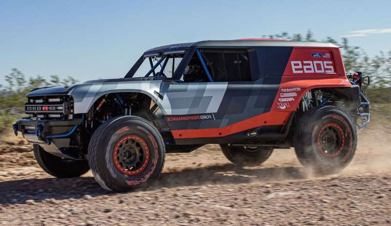 a red truck driving down a dirt road: The production Bronco takes shape—and if the real thing looks half as cool as this SEMA-bound prototype, we'll be satisfied.