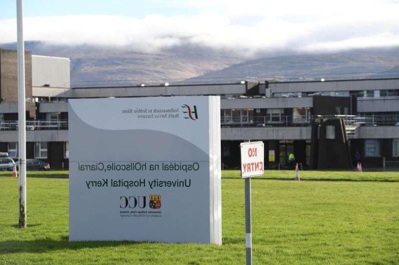 a sign in a field: University Hospital Kerry (stock image)