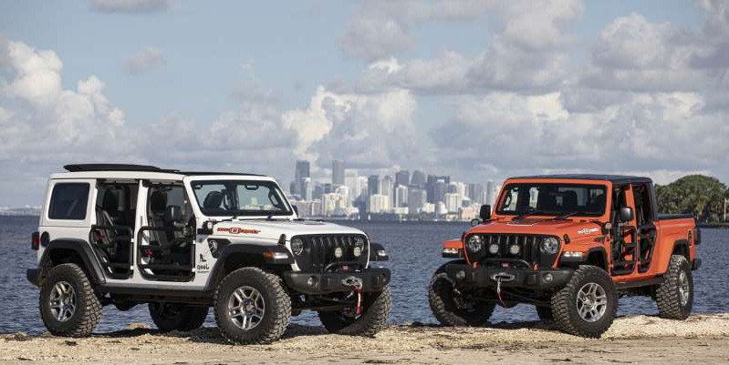 a truck driving down a dirt road: They're not just for show, despite the kite-surfer decals. A limited number of 305 of these Mopar-modified Jeeps will be available to buy, but only in Florida.