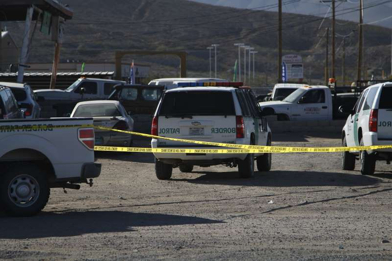 Border Patrol and other law enforcement agents guard the scene of a fatal shooting on Monday, Nov. 4, 2019, in Sunland Park, N.M, a suburb of El Paso, Texas. Customs and Border Protection officials said an armed man was fatally shot by an agent after he opened fire first. The scene is about 1 mile (1.6 km) away from the U.S.-Mexico border. (AP Photo/Cedar Attanasio)