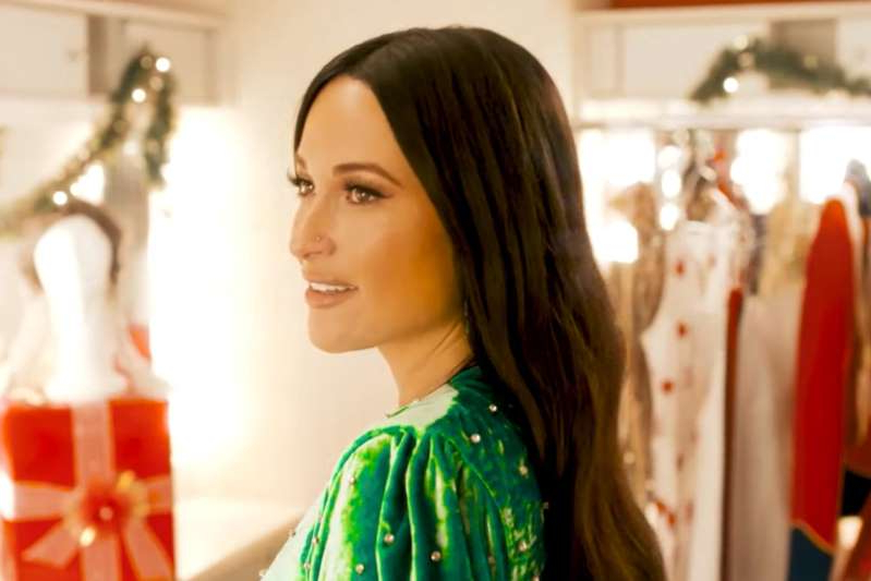 Kacey Musgraves standing in front of a mirror posing for the camera: The Kacey Musgraves Christmas Show | Photo Credits: Amazon Prime