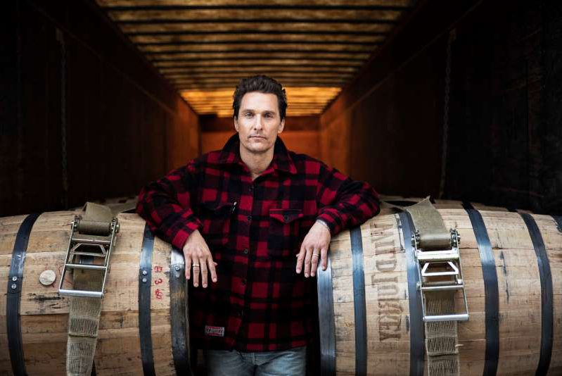 Matthew McConaughey standing in front of a barrel: Matthew McConaughey.