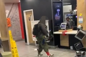 Shocking moment furious man goes on the rampage in McDonald's smashing up the tills and screaming at staff in front of terrified customers