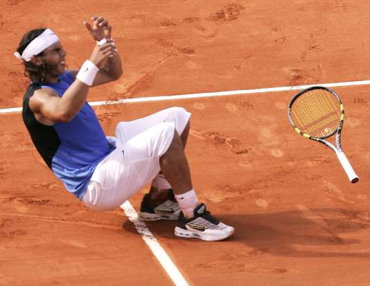 Slide 10 of 38: Spain's Rafael Nadal falls on the clay as he defeats Switzerland's Roger Federer in the men's final match during the French Open tennis tournament at the Roland Garros stadium in Paris, Sunday June 11, 2006. Nadal won 1-6, 6-1, 6-4, 7-6.