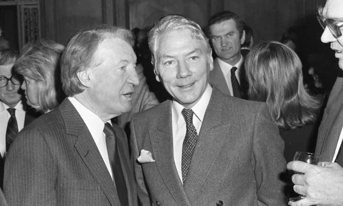 Slide 2 of 26: An Taoiseach Charles Haughey with Gay Byrne officially launching the National Lottery at a special reception in the Royal Hospital, Kilmainham, 23/03/1987 (Part of the Independent Newspapers Ireland/NLI Collection). (Photo by Independent News and Media/Getty Images).