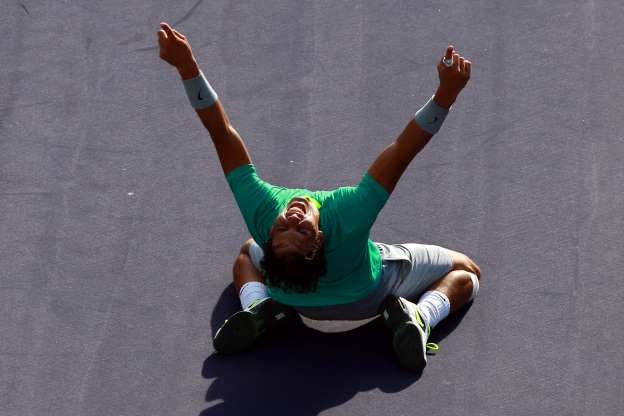 Slide 24 of 38: Rafael Nadal of Spain celebrates after defeating Juan Martin Del Potro of Argentina to win the men's final match of the 2013 BNP Paribas Open at the Indian Wells Tennis Garden on March 17, 2013 in Indian Wells, California.