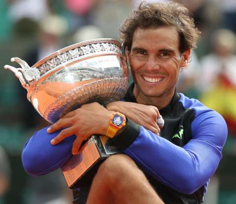 Slide 32 of 38: Rafael Nadal of Spain holds the trophy during his Men's Singles Final match against Stan Wawrinka of Switzerland, on day fifthteen at Roland Garros on June 11, 2017 in Paris, France.