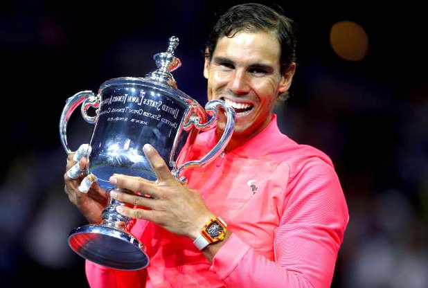 Slide 33 of 38: Rafael Nadal of Spain celebrates winning the US Open title with the trophy