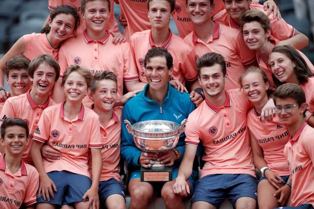 Slide 35 of 38: Tennis - French Open - Roland Garros, Paris, France - June 10, 2018   Spain's Rafael Nadal celebrates with ball boys, ball girls and the trophy after winning the final against Austria's Dominic Thiem    REUTERS/Benoit Tessier     TPX IMAGES OF THE DAY