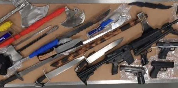 a close up of a gun: These are some of the weapons that were seized from two residences in Albert Park on Oct. 24.