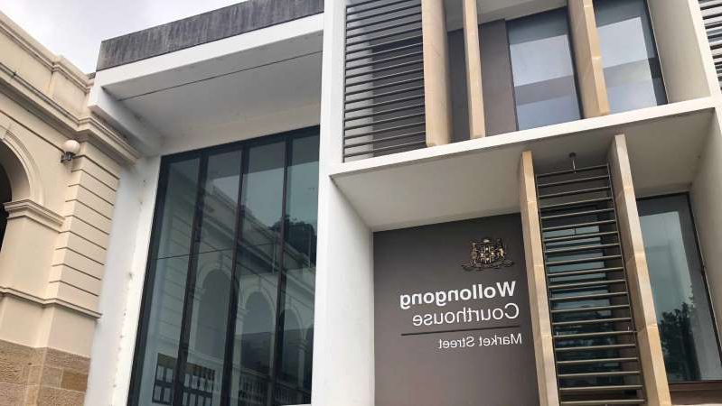 a sign in front of a building: A magistrate granted the man bail at Wollongong Local Court. (ABC Illawarra: Hannah Laxton-Koonce)