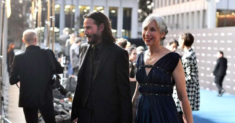 Alexandra Grant et al. that are talking to each other: Keanu Reeves Holds Hands with Artist Alexandra Grant on the Red Carpet