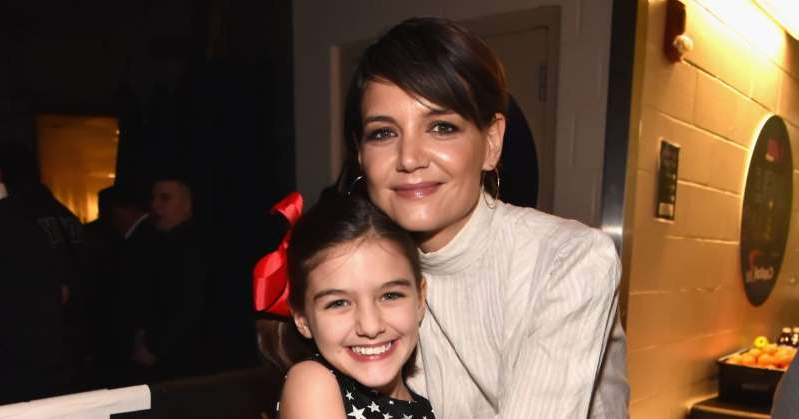 Katie Holmes, Suri Cruise are posing for a picture: Katie Holmes Talks About Becoming a Mom to Daughter Suri in Her 20s: 'We Kind of Grew Up Together'
