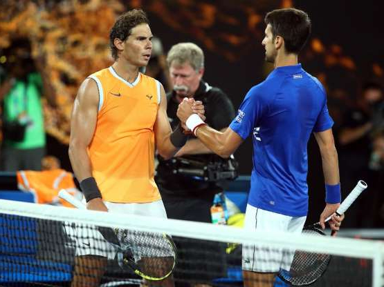 Rafael Nadal et al. standing on a court with a racket: The duo should be going head-to-head in London for the battle to become the year-end world No 1