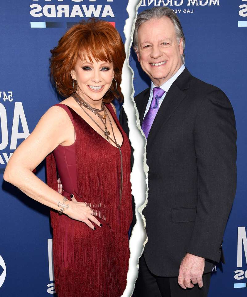Reba McEntire standing next to a man in a suit and tie: Anthony