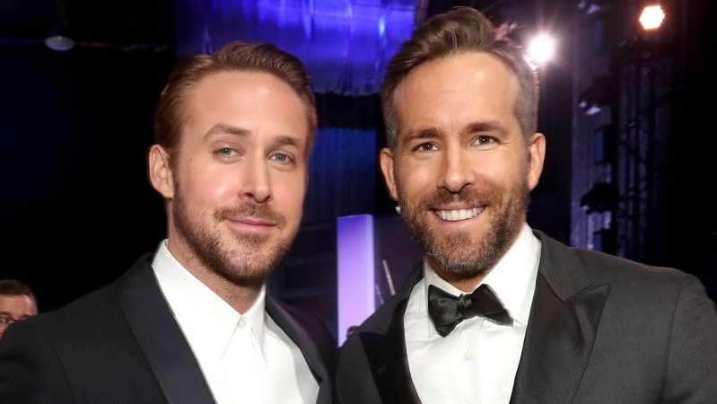 Ryan Reynolds, Ryan Gosling are posing for a picture: Ryan Reynolds and Ryan Gosling.