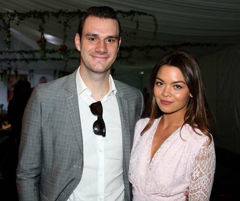 Scarlett Byrne, Cooper Hefner are posing for a picture: Cooper Hefner and Scarlett Byrne posed together at the Playboy Mansion in Los Angeles on May 14, 2015.