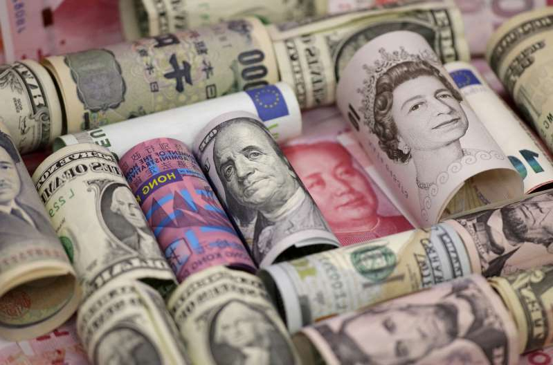 a bunch of items that are sitting on a counter: FILE PHOTO: Euro, Hong Kong dollar, U.S. dollar, Japanese yen, British pound and Chinese 100-yuan banknotes are seen in a picture illustration