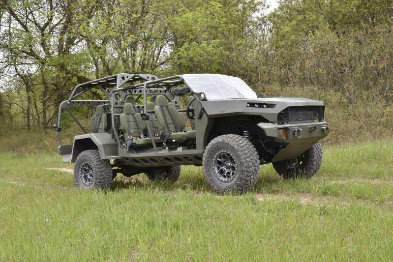 a car parked in a grassy field: chevrolet-colorado-zr2-based-infantry-squad-vehicle-lead