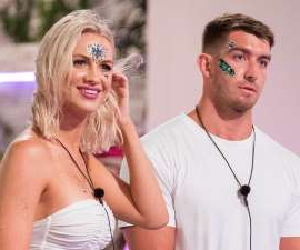 a couple of people posing for the camera: Isabelle was eliminated from the Love Island Villa on Wednesday night, after failing to make a connection with newbie Blake. As he re-coupled with another newbie, Margarita, Isabelle was left in a 'vulnerable' position going in to the elimination. Fortunately, she was happy to be sent home now.