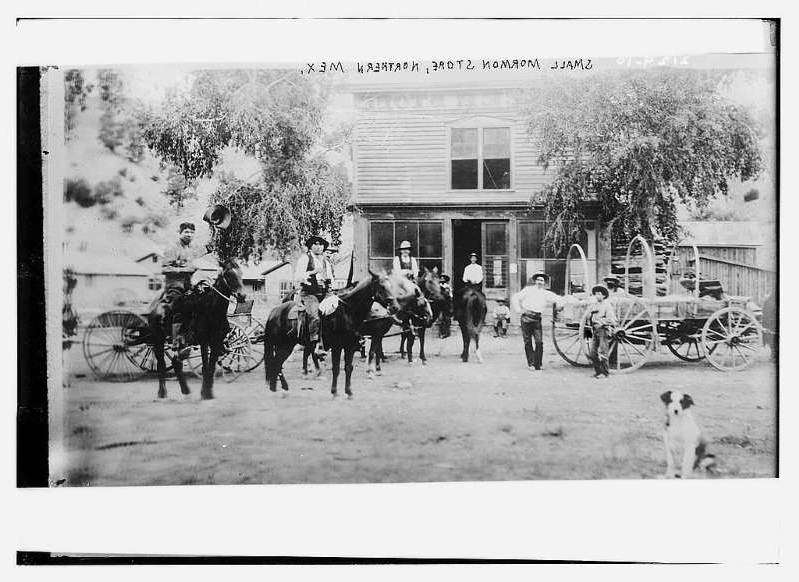 a group of people riding on the back of a horse drawn carriage: A Mormon-owned store in northermn Mexico, circa 1900. (Library of Congress)