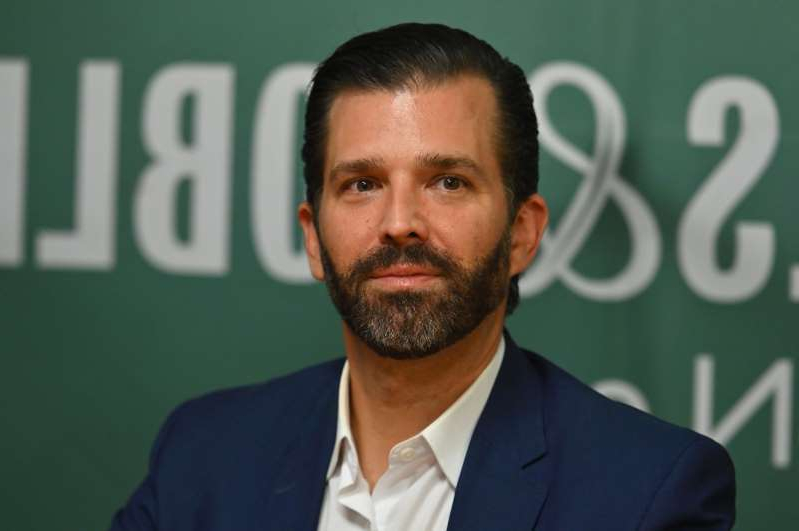 Donald Trump Jr. wearing a suit and tie: Donald Trump Jr., poses during a signing event for his new Book