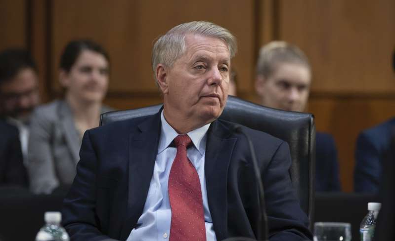 Lindsey Graham wearing a suit and tie