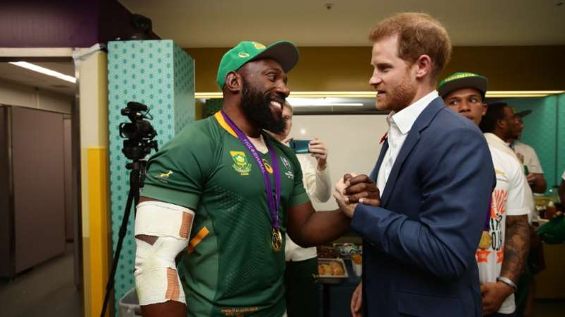 Prince Harry et al. standing in a room: 'Beast' calls it quits after Boks' RWC win