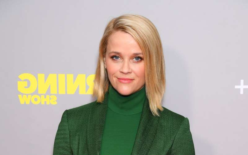 Reese Witherspoon wearing a green shirt: Reese Witherspoon -David Fisher/Shutterstock
