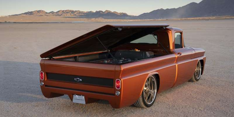 a car parked on a beach: Tech borrowed from the Chevrolet Bolt EV and fitted to a 1962 C-10 brings about a modern take on the hot-rod pickup at SEMA.