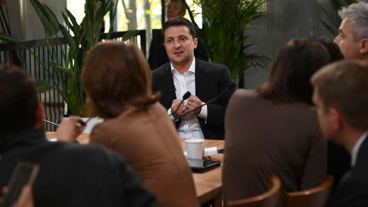 a group of people sitting at a table: President Volodymyr Zelensky of Ukraine took office in May. His new administration quickly fell under pressure from President Trump and his allies.