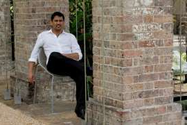 a man standing in front of a brick building: Danny Bhandari, the entrepreneur and enthusiastic cricketer, in 2012.