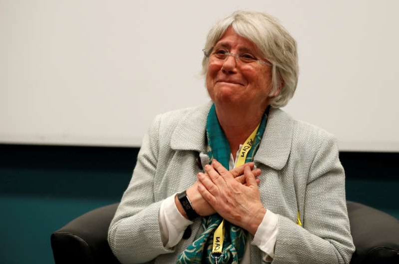 a man wearing a green shirt: FILE PHOTO: Catalonia's former Education Minister Clara Ponsati attends a fringe meeting at the Scottish National Party conference in Aberdeen,  Scotland