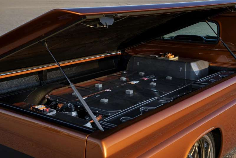 a stove top oven sitting inside of a car: Chevrolet E-10 SEMA