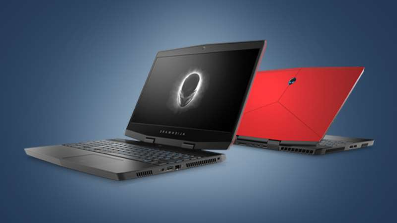 an open laptop computer sitting on top of a table: Alienware m17 gaming laptop deal
