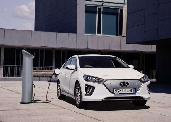 a car parked in front of a building: Keep scrolling or clicking to check out even more pictures of the whole 2020 Ioniq lineup.
