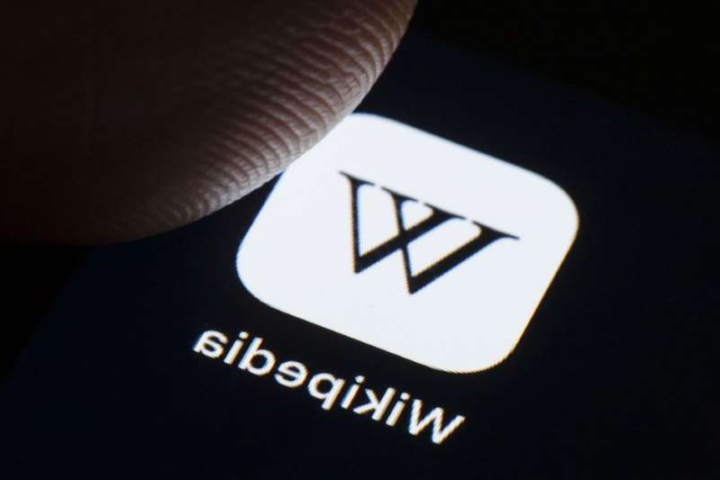 a close up of a logo: The Internet Archive and Wikipedia are teaming up to help users verify citations calling back to physical texts by turning them digital. Getty Images
