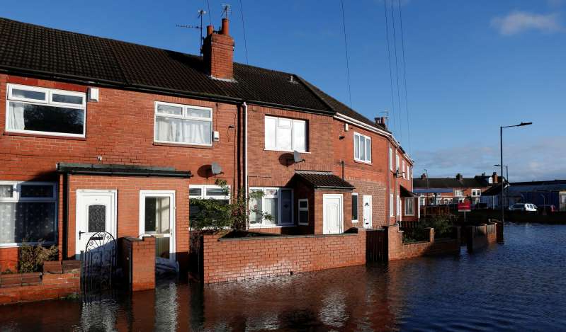 a large brick building: A general view shows a flooded street in Bentley, north of Doncaster