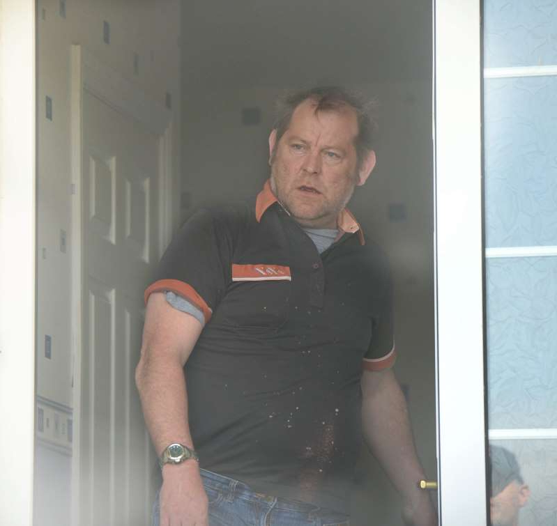 a man standing in front of a door: Cyril Mc Guinness aka