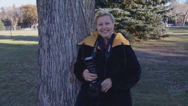 a man standing next to a tree: After decades of fearing the camera, Deborah Kinisky has now turned a camera into the tool for her career.