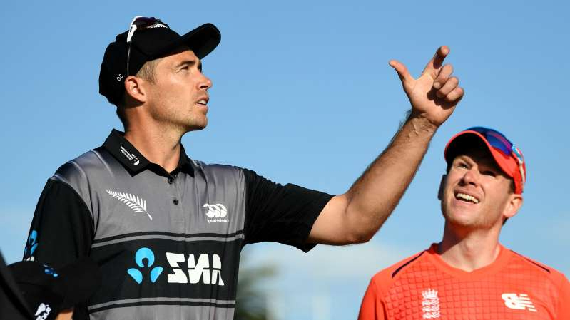 a man wearing a black shirt: Tim Southee (R) could not stop Eoin Morgan (L) and England's onslaught on Friday