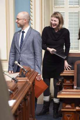 a person in a suit and tie:  Quebec solidaire MNA Catherine Dorion enters the legislature in Quebec City on Wednesday, December 5, 2018 in Dr. Martens boots.