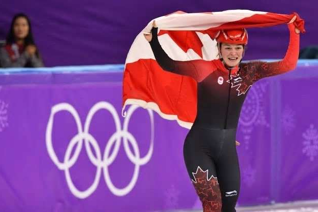 a person posing for a picture: Canada's Kim Boutin, seen above at the 2018 Olympics in Pyeongchang, represents the next wave of Canadian short track athletes after emerging with three medals.