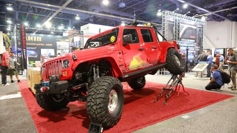 a red and black truck sitting on top of a building: Jeep Gladiators of SEMA 2019 49