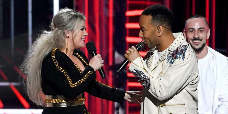 Christophe Lepoint et al. with red hair: LAS VEGAS, NV - MAY 20:  Recording artist John Legend (L) and host Kelly Clarkson speak onstage during the 2018 Billboard Music Awards at MGM Grand Garden Arena on May 20, 2018 in Las Vegas, Nevada.  (Photo by Kevin Winter/Getty Images)