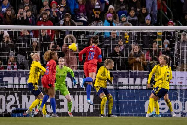 COLUMBUS, OH - NOVEMBER 07:  Carli Lloyd #10 of the United States attempts a head shot as Hedvig Lindahl #1 of Sweden defends during game action of an international friendly match between the United States and Sweden on November 07, 2019, at Mapfre Stadium in Columbus, OH. (Photo by Adam Lacy/Icon Sportswire via Getty Images)