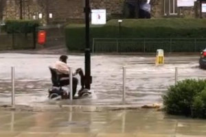 Determined mobility scooter user spotted driving through floodwaters in Sheffield